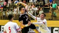 Guntis Piļpuks (ar bumbu)  Foto: Handball Austria
