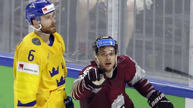 Adams Lāšons un Teodors Bļugers. Foto: Reuters/Scanpix