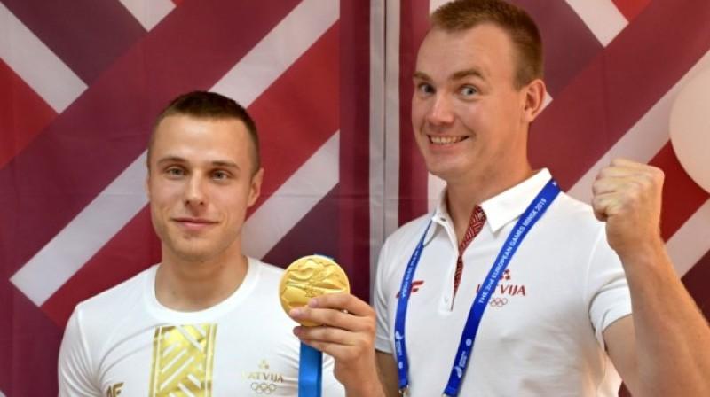 Kalvis Kalniņš un treneris Rolands Družoks. Foto: Mārtiņš Mālmeisters, Latvijas Olimpiskā komiteja
