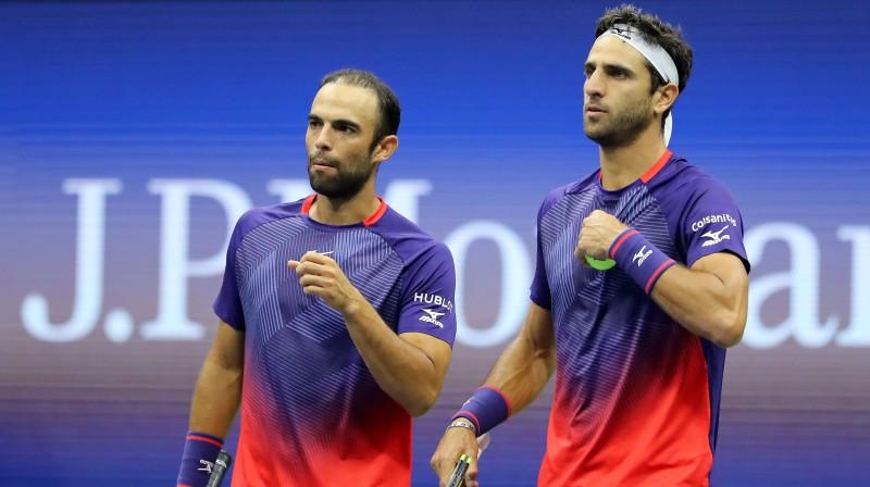 Huans Sebastjans Kabals un Roberts Farahs. Foto: AFP/Scanpix
