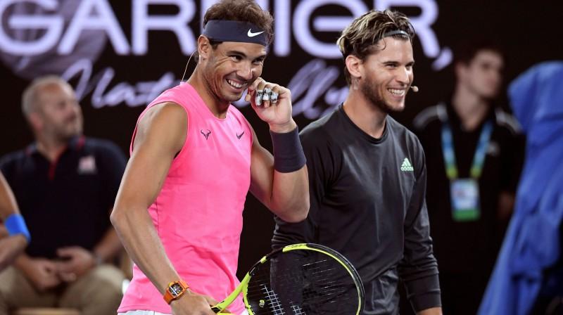 Rafaels Nadals un Dominiks Tīms labdarības pasākumā dažas dienas pirms turnīra sākuma. Foto: AFP/Scanpix