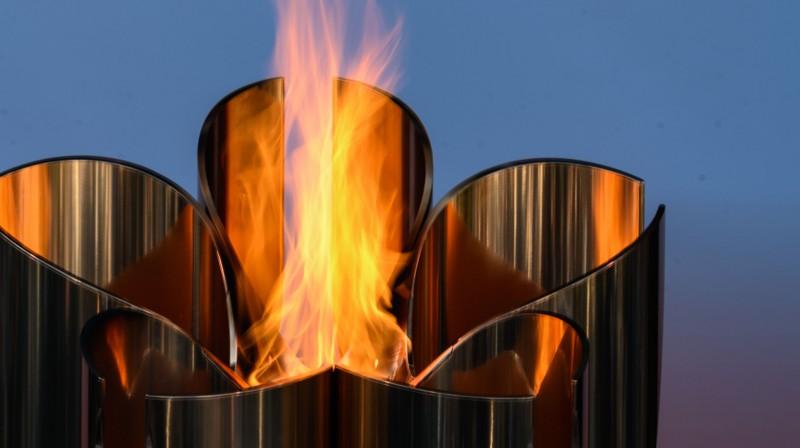 Olimpiskā uguns nogādāta Japānā. Foto: AFP/Scanpix