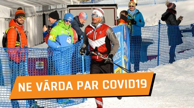 Ilmārs Bricis steidz palīgā. Foto: Latvijas Biatlona federācija
