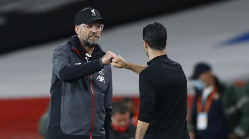 Jirgens Klops un Mikels Arteta. Foto: Reuters/Scanpix