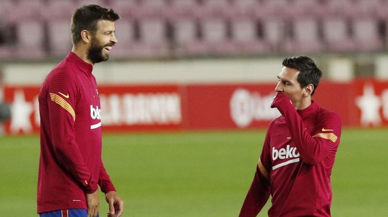 Žerārs Pikē un Lionels Mesi. Foto: Reuters/Scanpix