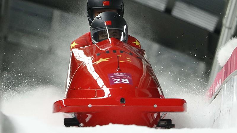Ķīnas bobsleja ekipāža. Foto: Reuters/Scanpix