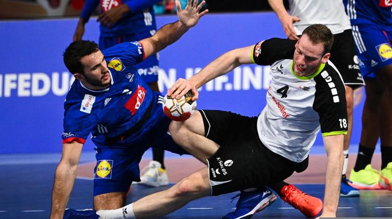 Cīņa starp Francijas un Šveices handbolistiem. Foto: AFP/Scanpix