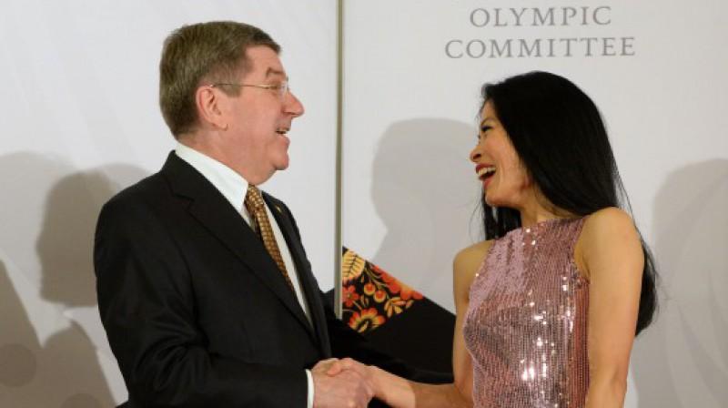 SOK prezidents Tomass Bahs un Vanesa Meja Vanakorna olimpiskajās spēlēs 2014 Foto: AFP / Scanpix
