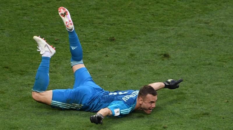 Igors Akinfejevs svin uzvaru pār Spāniju. Foto: SIPA/Scanpix