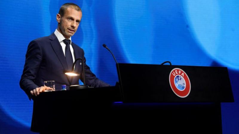UEFA prezidentam Aleksandaram Čeferinam liela uzvara, nosargājot (vismaz uz laiku) ierasto sistēmu. Foto: AFP/Scanpix