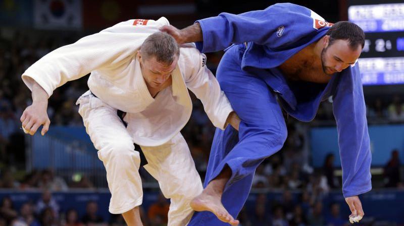 Jevgeņijs Borodavko (no labās) Londonas olimpiskajās spēlēs. Foto: AP/Scanpix