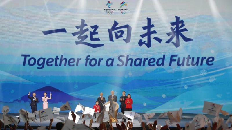 Pekinas olimpisko spēļu sauklis. Foto: EPA/Scanpix